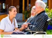 photo of a volunteer helping a senior
