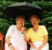 photo of two senior women sitting on a bench